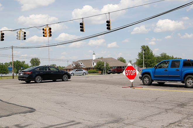 A pickup truck waits at the temporary stop sign on Towsnhip Road 1153 to cross U.S. Route 42 during the power outage Thursday in Ashland County.