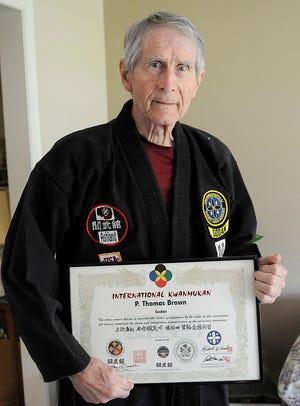 Tom Brown poses with his Godan certificate, fifth degree black belt on Thursday, May 20, 2021. TOM E. PUSKAR/TIMES-GAZETTE.COM