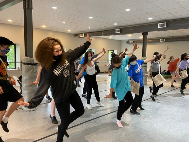 """The cast of """"Newsies"""" practices a dance routine at Jessye Norman School of the Arts Wednesday, May 19. Performances will be held at Davidson Fine Arts Magnet School June 11-13."""
