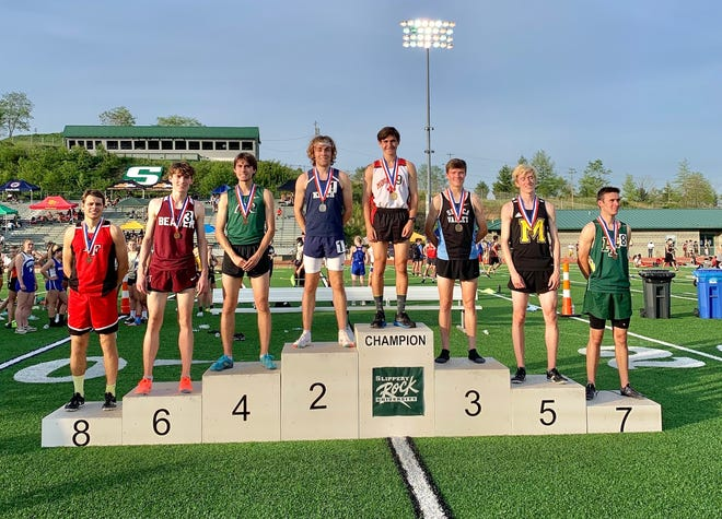 Moon's Jacob Puhalla smiles with his gold medal after winning the 800 at the 2021 WPIAL 3A championships