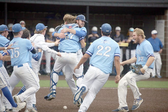 Members of the Boonville Pirates baseball team react after capturing the championship in the Class 4 District 7 Tournament Wednesday night in Ashland.