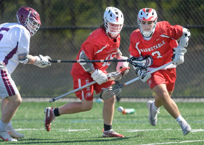 Dillon Huntington (3) and Owen O'Connor of Barnstable go after the ball defended by Henry Peters of Falmouth. Huntingtonscored six goals and assisted on a seventh in the Red Hawks' 10-6 boys lacrosse win over the Clippers Thursday in Falmouth.