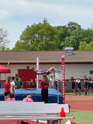 Noah Buh is pictured participating in high jump.