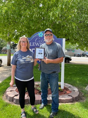 Lewistown's Music in the Park received the Governor's Hometown Award. Pictured is Karen King and Lewistown Mayor, Doug Lafary.