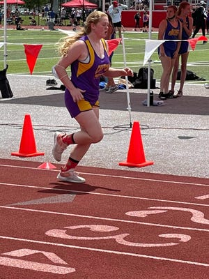 Bri Putman is pictured participating in the 800 meter run.