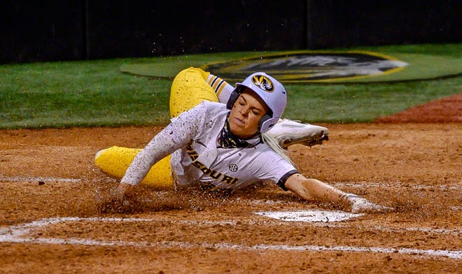 Missouri's Casidy Chaumont (12) slides into home during a game against LSU on April 9 at Mizzou Softball Stadium.