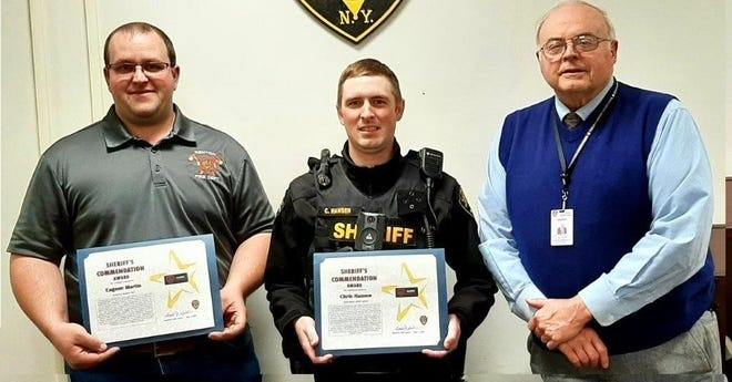 First Responder Eugene Martin and Deputy Sheriff Chris Hansen were commended by Sheriff Ron Spike for their quick actions in saving the life of an overdose victim last month.