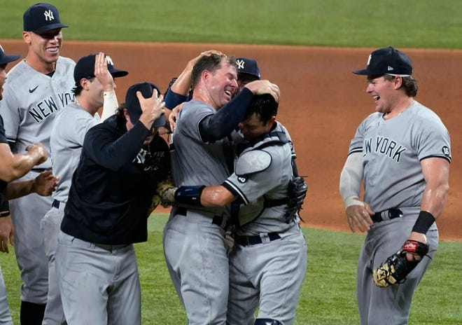 New York Yankees pitcher Corey Kluber, without his hat, is congratulated by his teammates after throwing a no-hitter against the Texas Rangers on Wednesday, the sixth no-hitter in the major leagues this season.