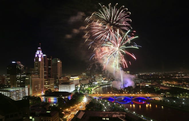 Fireworks light up the skyline during the annual Red, White and Boom display in downtown Columbus on Wednesday, July 3, 2019. [Adam Cairns/Dispatch]