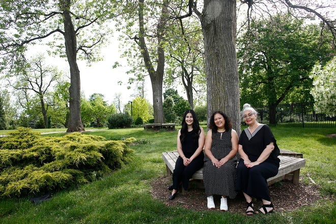 From left, Sophia Antoun, Jona Hilario and Deb Papesh are hopeful that the Asian Festival, which will take place virtually this year, can help forge a better understanding of the Asian American community. The women are shown on the Franklin Park Conservatory and Botanical Gardens grounds. The festival often takes place in Franklin Park.