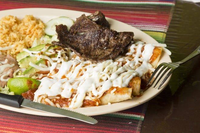 Steak enchiladas with red sauce at Tacos Don Deme