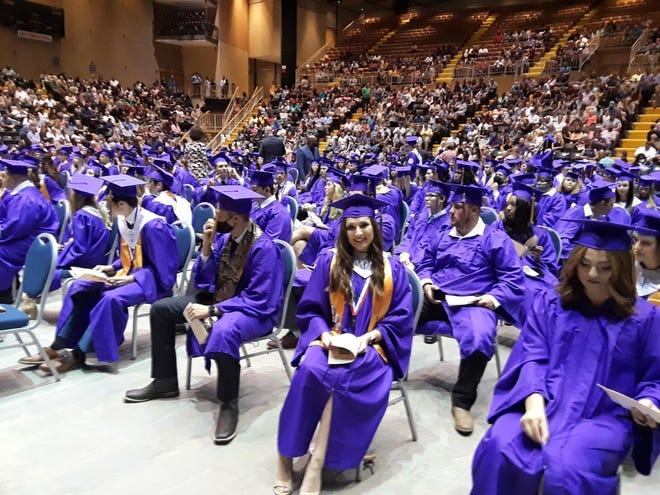 Thibodaux High School seniors await their diplomas Wednesday at the Thibodaux Civic Center.