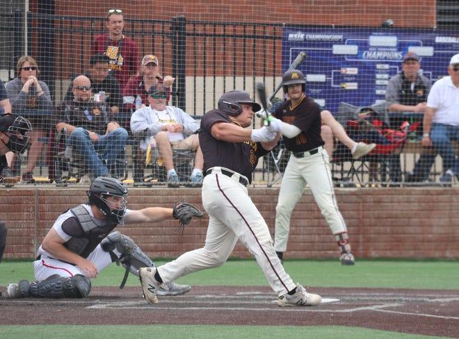 Brock Reller takes a swing.