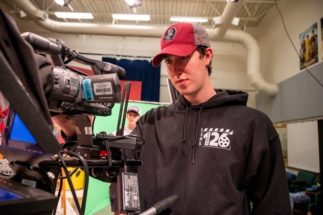 Nico Wilcox runs the camera at Studio 126 at Eustis High School. [Cindy Peterson/Correspondent]