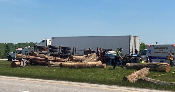 State Highway Patrol troopers and first responders from three fire departments in Guernsey County examine the wreckage after a log truck overturned on I-70 at the Old Washington exit. The 40-year-old driver suffered multiple injuries and was transported by ambulance to Southeastern Med in Cambridge.