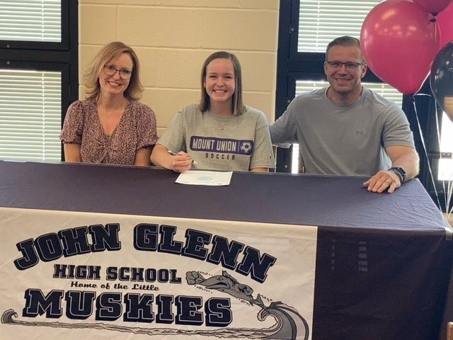 John Glenn senior Shilynn Williamson signed to play soccer next year at the University of Mount Union n Tuesday. Shilynn is in the middle with her mother, Carrie, on the left, and her father, Dave, on the right.