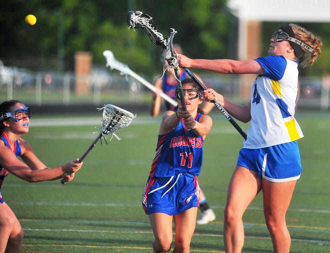 Wooster's Leah Sanchez fires on goal. Sanchez scored a game-high six goals to lead Wooster to a 13-10 playoff win over Bay.