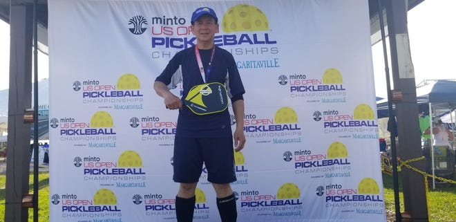 Thinh Nguyen is pictured after winning the gold medal in the 50-55 age bracket in men's single play at the U.S. Open Pickleball Championships in Naples, Fla.
