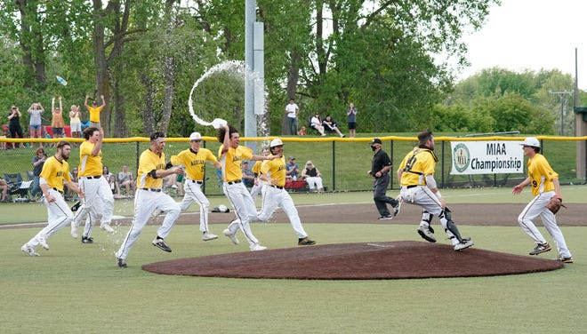 Adrian College's bench storms the field after the final out of the MIAA baseball championship Thursday in Adrian.