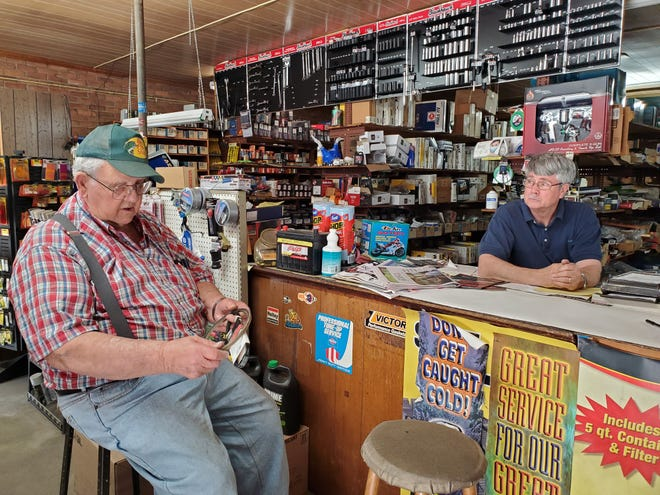 Customer Donald Nifong (left) talks with Four Speed Auto Parts & Paint owner Jim Koontz about a belt he needs. The Welcome community store is celebrating 50 years of business this year.
