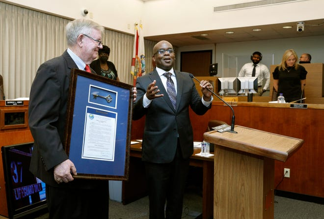 City and local officials honor retiring city manager Jim Chisholm during city commission meeting at City Hall in Daytona Beach, Wednesday, May 19, 2021.