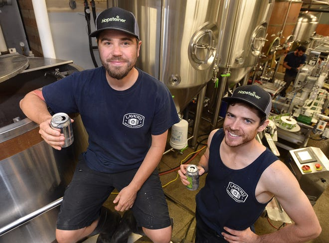 Jason Lavery, president and brewer, at left, and Logan Hartpence, brewer, at right, are shown at Lavery Brewing Co., 128 W. 12th St., in Erie on June 11, 2018.