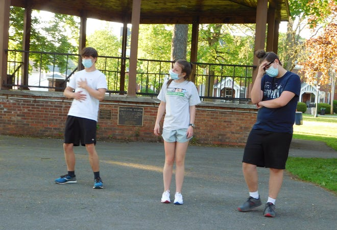 """From left, Herkimer High School students Peter Mosny, Abigail Polus and Jayden Crandall rehearse a scene from """"The Brothers Grimm Spectaculathon"""" by Don Zolidis. The play is one of two one-act comedies students will be performing this weekend in Myers Park in Herkimer."""