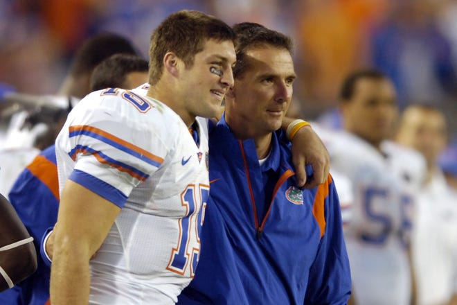 Tim Tebow (L), seen here in 2008 as a Florida quarterback celebrating a victory over Georgia with coach Urban Meyer, will have to prove he can help the Jaguars win if he's going to make it as an NFL tight end. Former Jaguars' tight end Kyle Brady explains why he faces long odds.