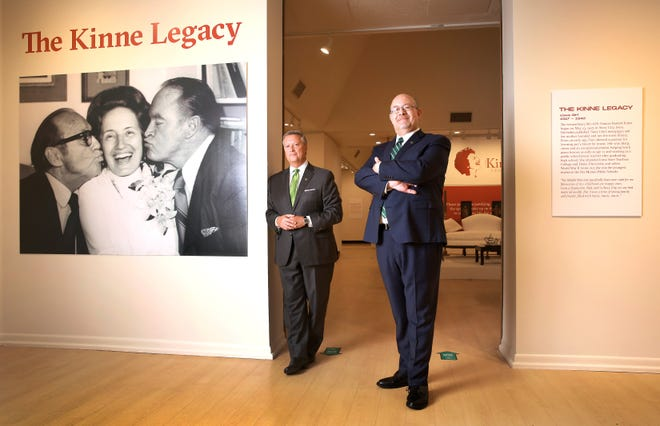 Jacksonville University President Tim Cost, left, and fine arts dean Tim Snyder, provide an early look at an exhibition to honor Fran Kinne, the former president of JU shown here sandwiched between kisses from Jack Benny and Bob Hope. The show opens to the public Sunday during a memorial to honor Kinne, who died last year at 102.
