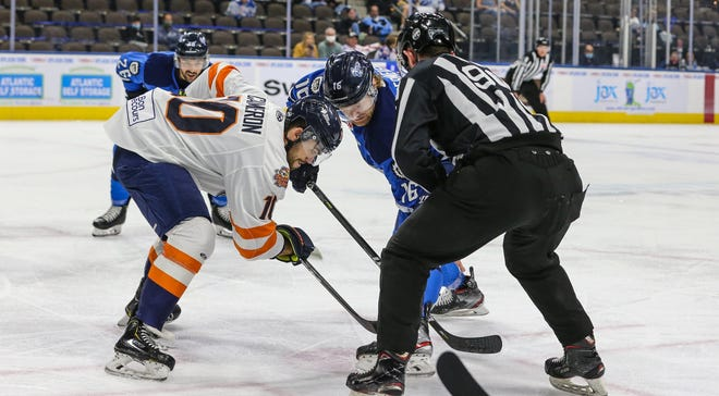 Greenville Swamp Rabbits forward Shawn Cameron (10) and Jacksonville Icemen forward Derek Lodermeier (16) faceoff during the first period of an ECHL hockey game at Veterans Memorial Arena in Jacksonville, Fla., Wednesday, May 19, 2021.  [Gary Lloyd McCullough/For the Jacksonville Icemen]