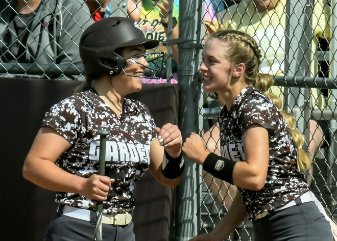 Garden City High School's Rilee McGraw, left, is congratulated by Brie Manwarren after hitting a two-run home run against Wichita Northwest Wednesday during the championship game of a 6A regional softball tournament at Tangeman Sports Complex.