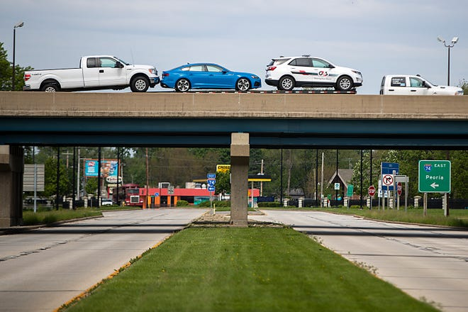 A truck hauling vehicles passes over East Main Street on I-74 on Thursday. The Illinois Department of Transportation's six-year improvement plan includes at least $65 million in road and bridge projects in Galesburg.