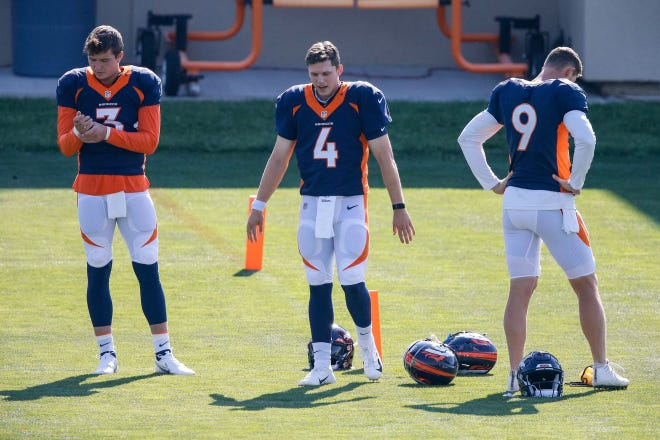 Broncos quarterbacks, from left, Drew Lock, Brett Rypien and Jeff Driskel take part in training camps at the UCHealth Training Center in Englewood, Colorado. Driskel, who was released by the Broncos earlier this month, was signed to a one-year deal with the Houston Texans in the uncertainty of Dashaun Watson's uncertain future with the team.