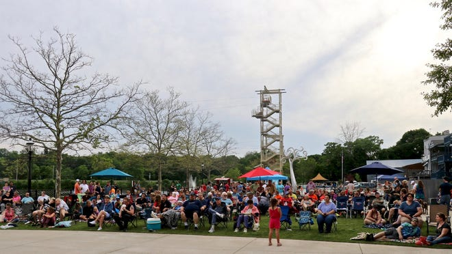 """Crowds enjoy downtown Allegan's """"Rollin' on the River"""" free summer concert series."""