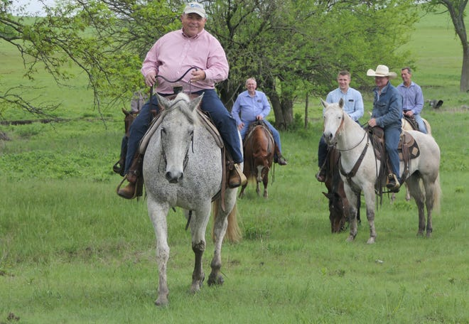 Zippy Duvall, president of the American Farm Bureau Federation, looks at the pasture at Paddy Creek Cattle Company in Morris County, Kansas.