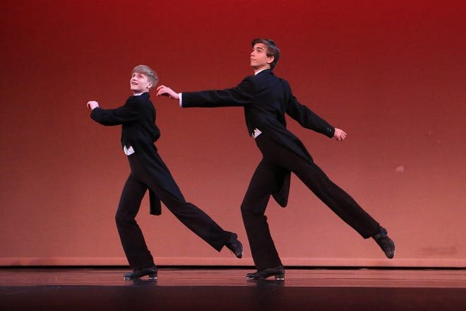 """ArtisTree dancers Jed Friesen, left, and Charlie Miller perform a tap danced titled """"Bringing the Lights to Broadway"""" during rehearsal for the 42nd Annual Spring Show""""Magnificent DanceScapes!"""" at the historic Fox Theatre Wednesday."""