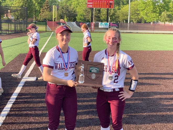 Walsh Jesuit captains Maddie Schmeiser (left) and Emma Barnes show off the district runner-up trophy Wednesday at Mentor.