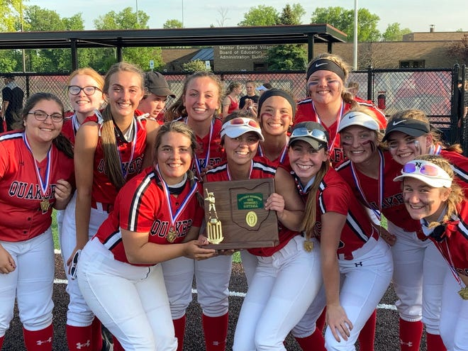 The New Philadelphia softball team poses with the district trophy after winning its first district title since 2006. The Quakers beat Walsh Jesuit 1-0 Wednesday at Mentor to claim the title.