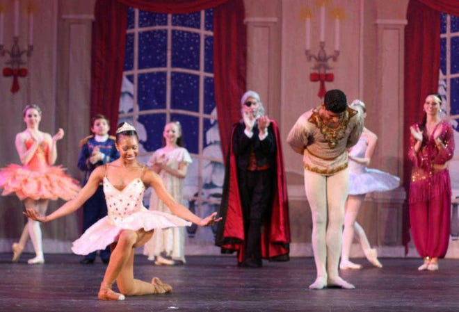 """NaTalia Johnson is pictured taking a bow after her performance as the Sugar Plum Fairy during a performance of Ballet Lubbock's """"The Nutcracker."""" A Lubbock native, Johnson, 37, died unexpectedly last week in Sacramento, California."""