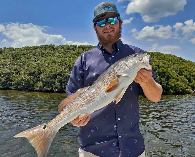 Jessie Estock, of Salt Springs, caught this redfish while fishing in Crystal River with Capt. Marrio Castello, of Tall Tales Charters on Tuesday.