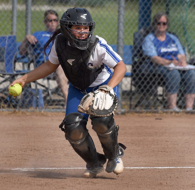 Catcher Emily Killion of Dundee chases down a bunt and throws the Ida batter out at first,