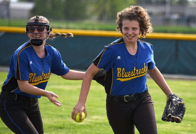 Right fielder Isabel Peron (right) of Ida was all smiles greeted by her teammate Alyssa Hogston after making a basket catch against Dundee Thursday. The teams split a doubleheader with Dundee taking the opener 6-2 and Ida winning the second 6-3.