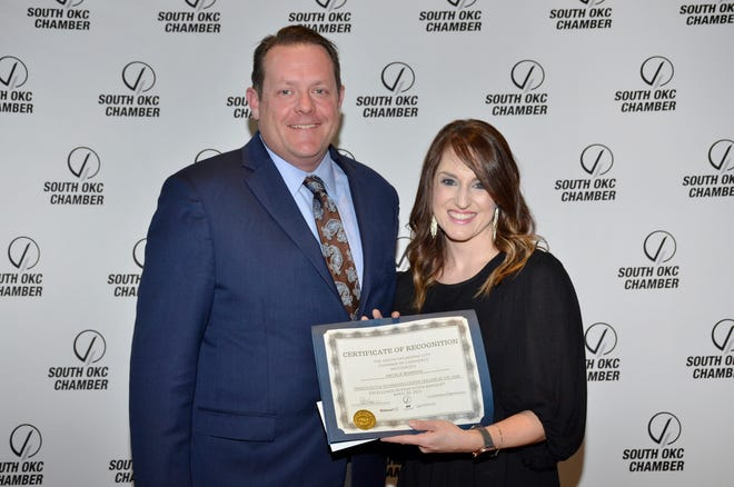 Mark Pierce,  Francis Tuttle Technology Center assistant superintendent, left, is pictured with Francis Tuttle instructor Natalie Bowman, recognized recently by the South Oklahoma City Chamber of Commerce as the 2021 Technology Teacher of the Year.
