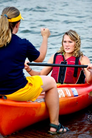 An individual receives instruction on using a kayak at Arcadia Lake. The University of Central Oklahoma's Center for Outdoor Adventure and Recreation has been renamed the UCO Boathouse at Arcadia Lake.
