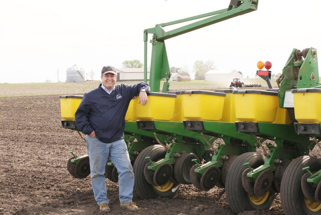 Jim Martin is shown with his planter.