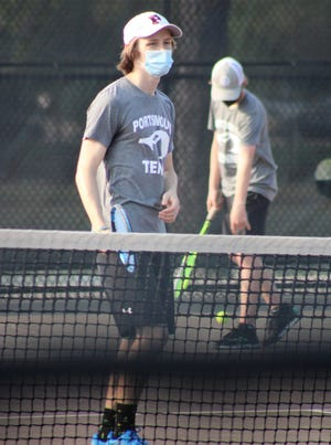 Portsmouth seniors Devon Starr (front) and Callum Stocker (back) during a doubles match against St. Thomas Aquinas on Wednesday at South Mill Playground in Portsmouth. Stocker and Starr won their match, 8-2.