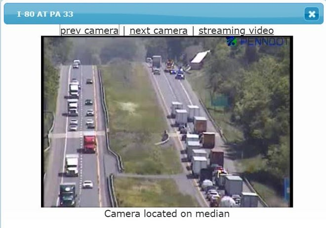 An image from a PennDOT camera around 1 p.m. Thursday appears to show police vehicles near an overturned truck, with traffic reduced to the left eastbound lane.