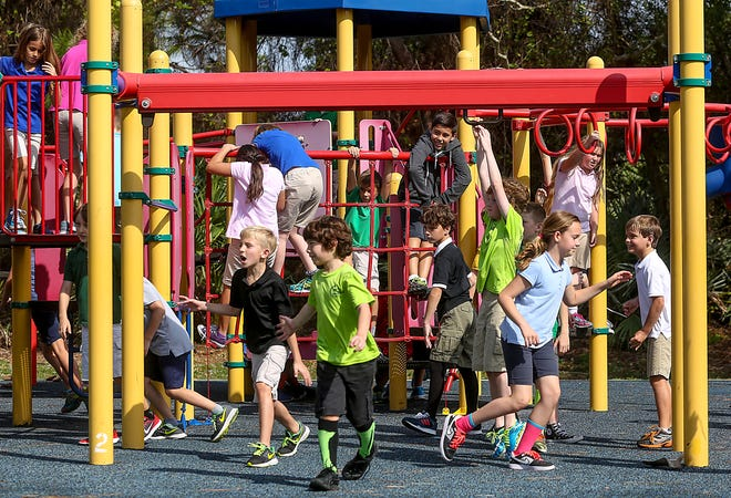 A fourth-grade class hits the playground at Limestone Creek Elementary in 2016.