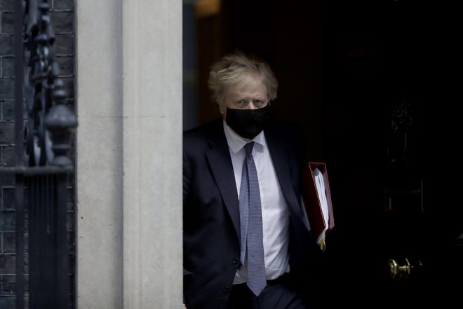 British Prime Minister Boris Johnson leaves 10 Downing Street to attend the weekly Prime Minister's Questions at the Houses of Parliament, in London on Wednesday, May 19.