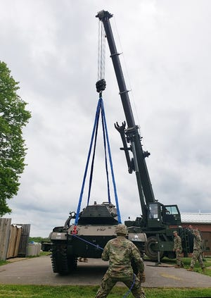 Horizontal construction engineer and bridge crewmember Soldiers with the 5th Engineer Battalion use one of their cranes to move a 23-ton M41 Walker Bulldog light tank May 11. The tank was on static display at the southeast corner of Iowa and Minnesota avenues. As they work to divest excess historic artifacts, museum staff here requested assistance from the battalion, which gains valuable training experience in exchange. Photo by Troy Morgan, U.S. Army Engineer Museum director.
